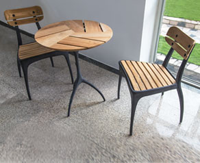 New Talon Zinc indoor / outdoor round bistro table with teak slats.